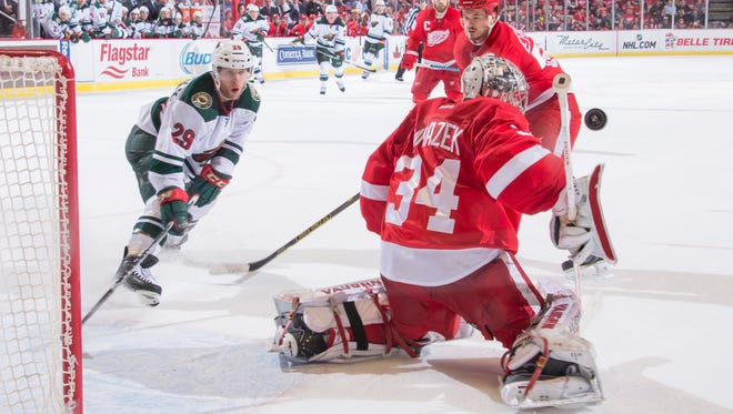Minnesota right wing Jason Pominville tries to get the puck past Detroit goalie Petr Mrazek in the overtime period.