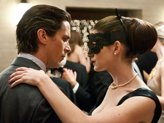 "Christian Bale, left, and Anne Hathaway in ""The Dark"