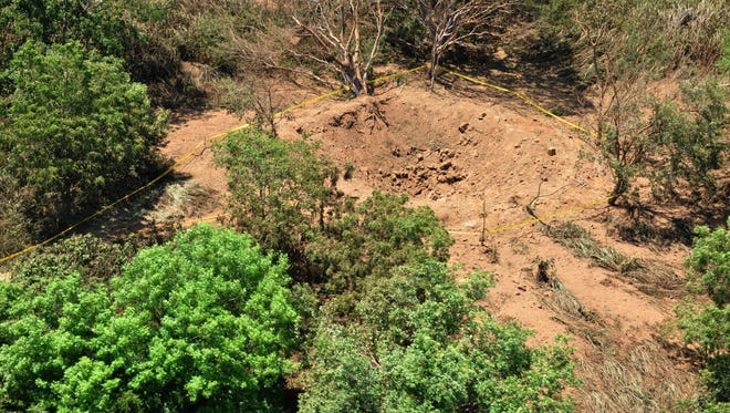 This photo provided by the Nicaraguan Army shows an impact crater made by a small meteorite in a wooded area near Managua's international airport.