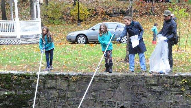 Glen Ridge Girl Scouts fish debris out of Toney's Brook as part of Clean Ocean Action's 31st year of semi-annual, statewide cleans ups on Saturday, Oct. 22, 2017.