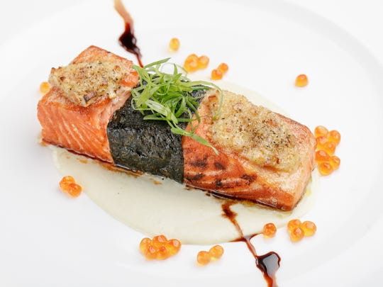 Roy's restaurant at the Hilton Guam Resort & Spa serves ora king salmon with crust celery puree in a Merlot balsamic butter sauce.