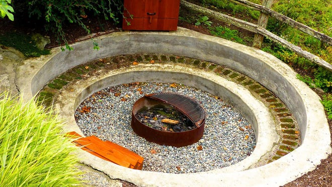 A fire pit at a home near Langley, Wash., that can comfortably seat eight to 10 people for cooking, cocktails and conversation. Wood-burning fire pits are cheaper to build and use than their gas-fueled counterparts and you can cook on them.