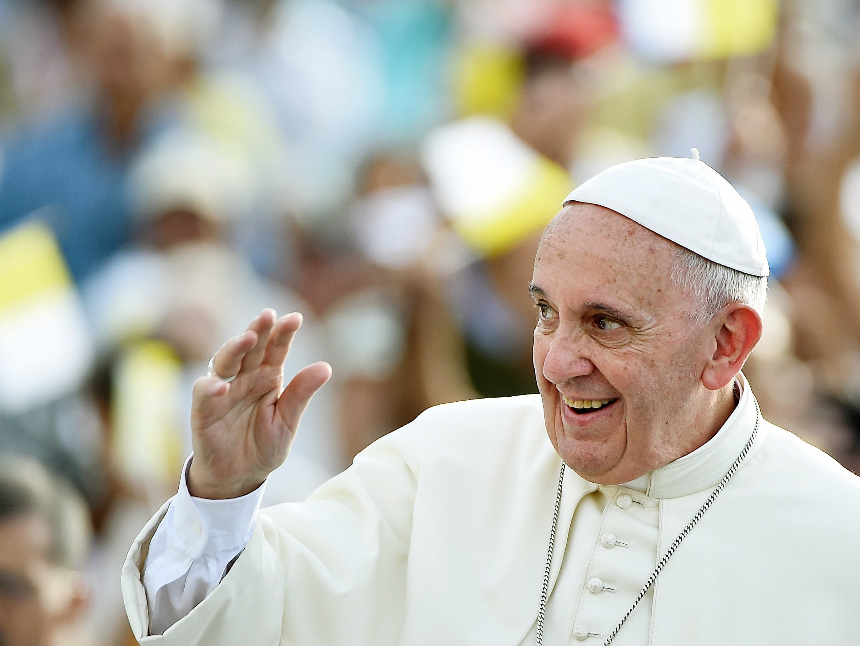 Pope Francis waves to the crowd upon his arrival in Santiago de Cuba. Santiago, the last stop on Pope Francis's Cuban tour, is known for its revolutionary history, its rum and the troubadours who have infused the Caribbean island's music with their t