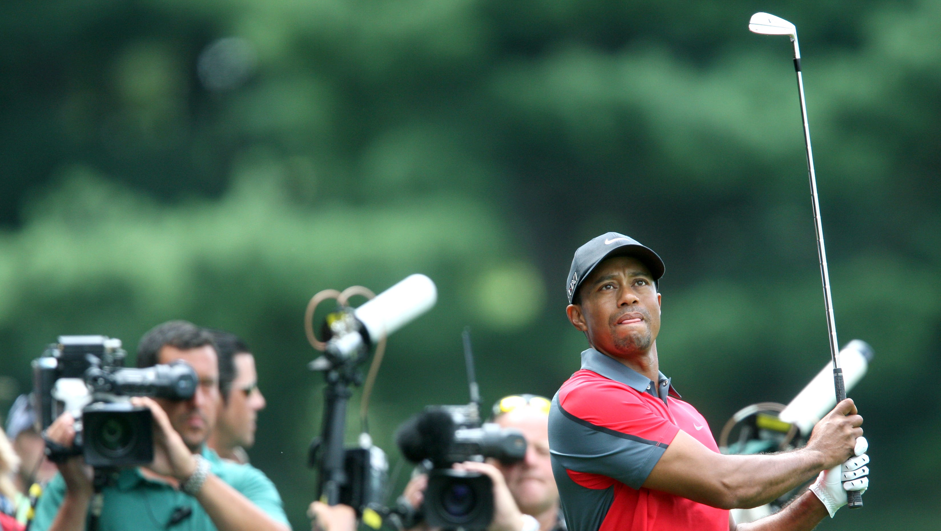 Tiger Woods swings on the 4 fairway during the final round of the 95th PGA championship at Oak Hill Country Club.