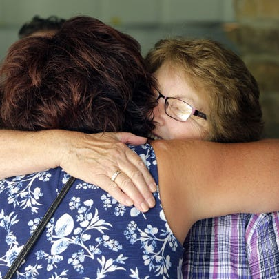 Therese Short, right, hugs her niece, Tammy Thompson,