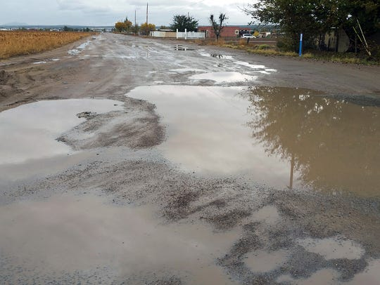 Cebolla Road in Vado after a recent rainstorm. The