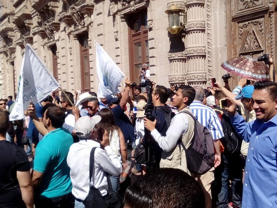 Protesters on Wednesday demand the resignation of Chihuahua Gov. César Duarte.