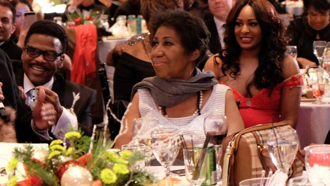 The Queen of Soul Aretha Franklin enjoys the festivities at her annual Christmas party on Tuesday at the International Banquet Center in Detroit.