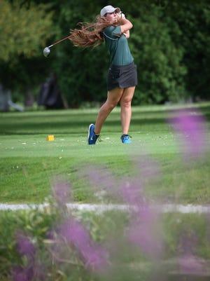Anna Smits of Oshkosh North hits a drive. The Oshkosh North girls golf team played the Kaukauna girls golf team Monday, August 25, 2014 at Westhaven Golf Couse.