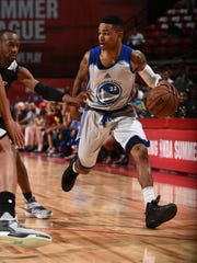 Keifer Sykes of the Golden State Warriors handles the