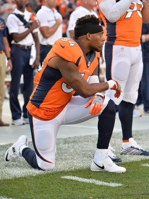 Broncos linebacker Brandon Marshall kneels during the national anthem at the NFL season opener.