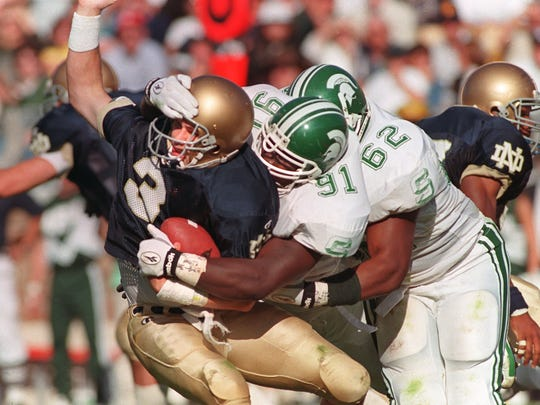 MSU defenders Robaire Smith (91) and Robert Newkirk