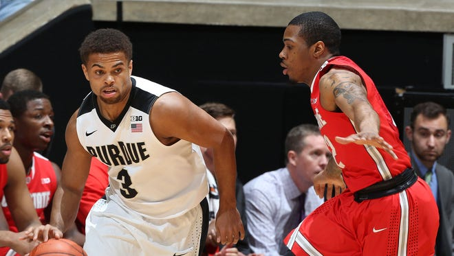 Boilermakers guard P.J. Thompson dribbles on the perimeter against the Ohio State Buckeyes at Mackey Arena.
