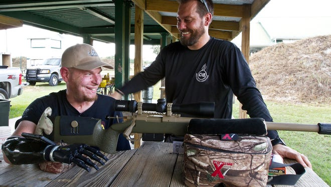 Combat-wounded veteran Mark Burlseon, who lost both hands to a bomb in Iraq, tries out a new custom rifle that will allow him to shoot again. The rifle was customized by Fort Myers-native/rifle maker Buck Holly of C & H Precision Weapons.