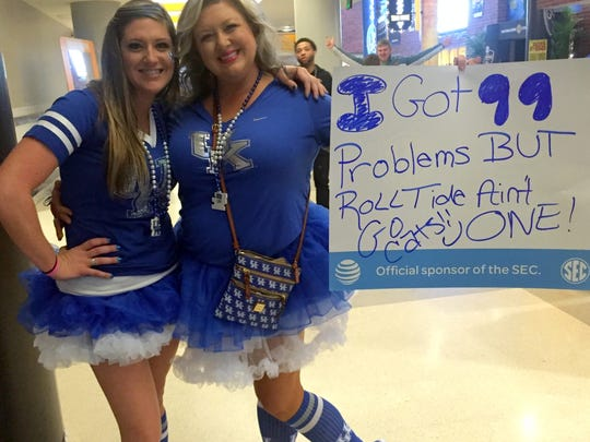 Sisters Holly Barber. left, and Dacia Flynt from Louisville show their support for Kentucky by dressing as outlandishly as possible.