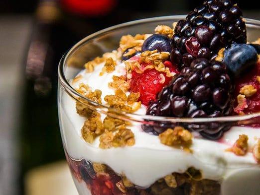 A colorful parfait of fresh berries, Greek yogurt and