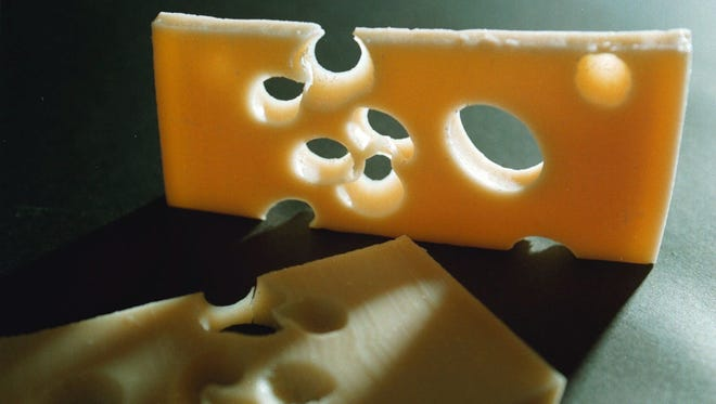 The mystery of the disappearing holes in the famous Swiss Emmental cheese has been solved: the milk is too clean.