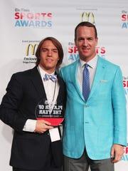 Peyton Manning poses with Jackson Boersma (Ruson) Male