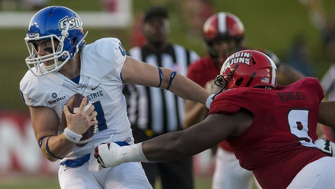Georgia State Panthers quarterback Nick Arbuckle (4) is sacked by UL Ragin Cajuns defensive lineman Christian Ringo (9) during the first half of an NCAA football game at Cajun Field in Lafayette, La., Saturday, Oct. 4, 2014. Paul Kieu, The Advertiser
