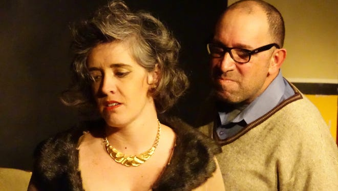 "Caroline Helm, left, and Danny Ladmirault are shown in a scene from ""Who's Afraid of Virginia Woolf?"""