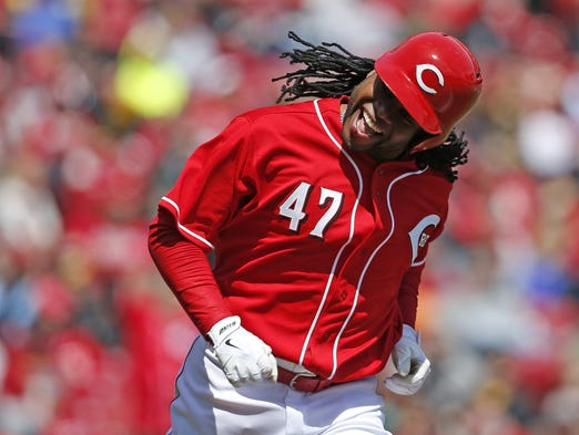 Cincinnati Reds starting pitcher Johnny Cueto (47) was all smiles after his seventh inning base hit.