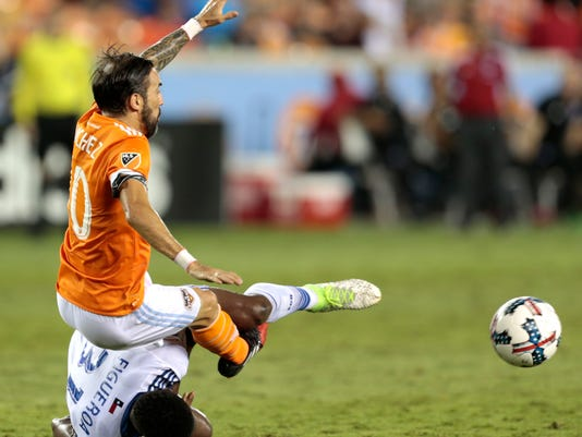 Houston Dynamo forward Vicente Sanchez (10) and FC Dallas defender Maynor Figueroa (31) become entangled while going for the ball during the second half of an MLS soccer game Friday, June 23, 2017, in Houston. (Brett Coomer/Houston Chronicle via AP)