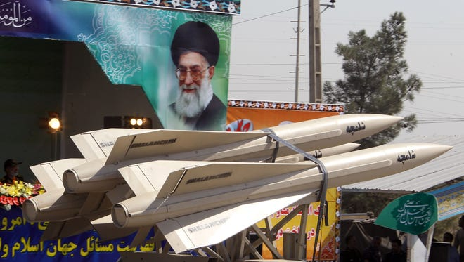 A military truck carries shalamcheh missiles during the an annual military parade in Iran. A new report says Iran may be a month from having enough weapons-grade uranium for a bomb.