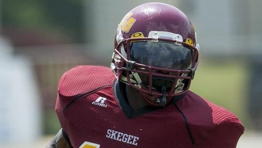 Tuskegee senior Dennis Norfleet transferred from Michigan and leads the Golden Tigers in rushing with 752 yards in 10 games.