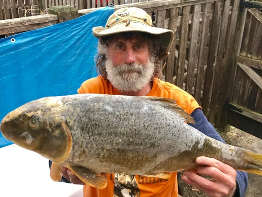 Michael Elwood, 61, of Burlington, displays a record-breaking