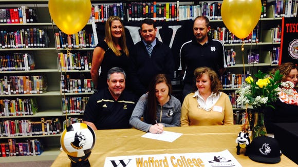 Rebecca Pickens (standing) attended last fall's college signing for senior Morgan Ballard.