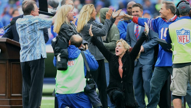 Family members of former Bills coach Lou Saban react after being surprised that his name was added wall of fame at Ralph Wilson Stadium.