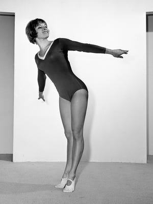 Former Olympic gymnast and 1963 National AAU All Around Women's champion Muriel Davis Grossfeld demonstrates the graceful pose that she is using in teaching mostly teenage girls about exercise and diet Feb. 5, 1965. She appeared at the Activity Room of Cain-Sloan.