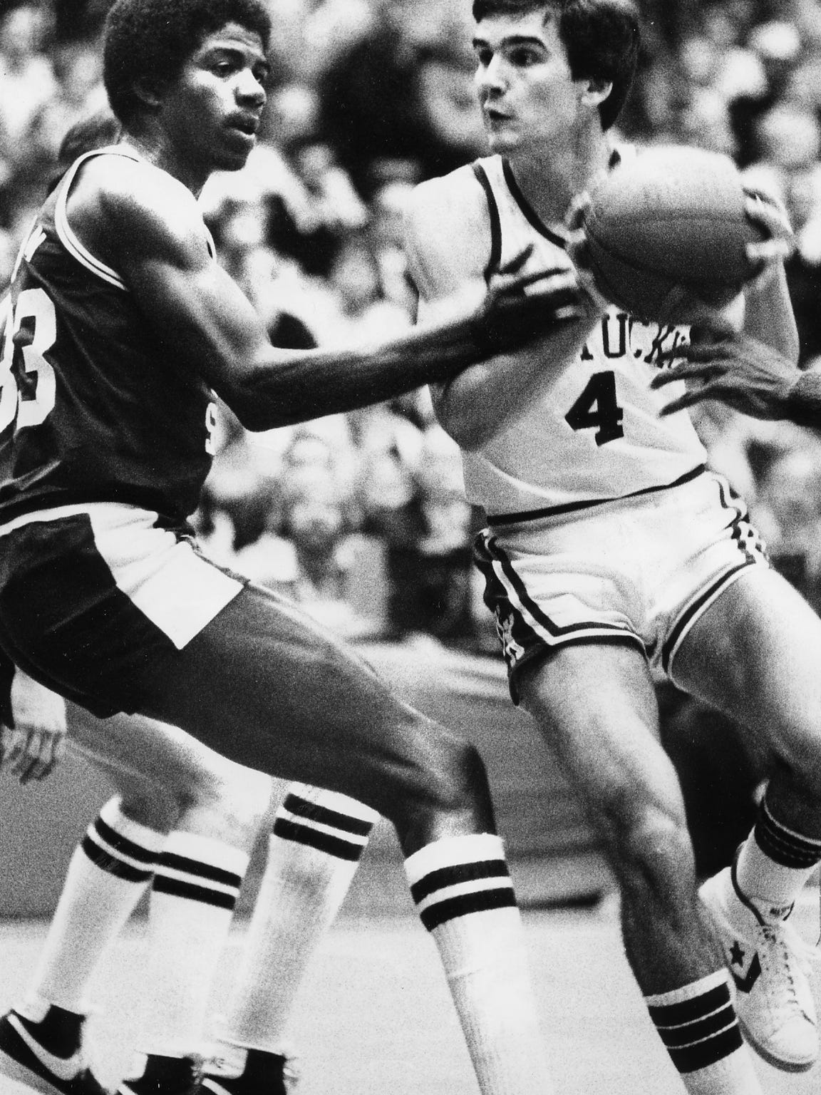 "UK'S Kyle Macy, right, with Michigan State's Earvin ""Magic"" Johnson in the NCAA Mideast Regional on March 18, 1978.