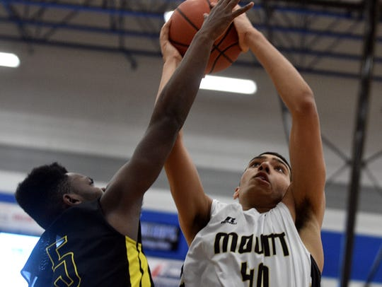 Mt. Juliet's Isaac Stephens elevates for an interior