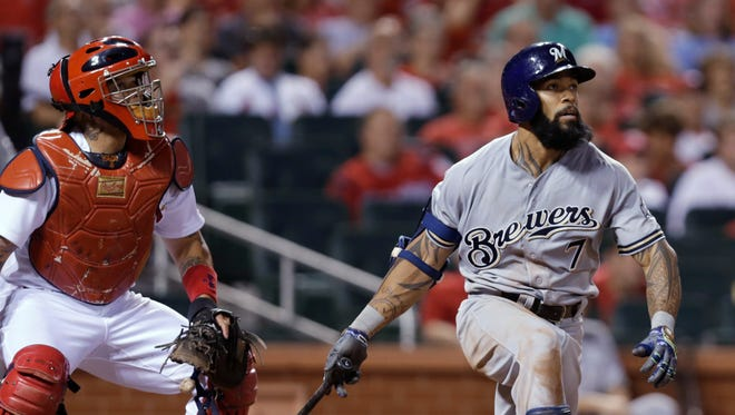 Milwaukee Brewers' Eric Thames watches his two-run home run in the ninth inning.