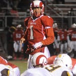 Trotwood-Madison (Ohio) QB Messiah deWeaver surveys the field during a playoff game last season. DeWeaver was named the QB MVP at a Nike regional camp in Chicago over the weekend.