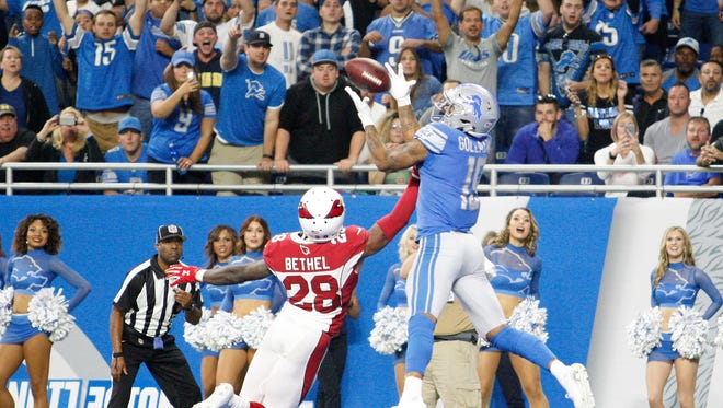 Kenny Golladay makes his first NFL touchdown catch in the fourth quarter against Cardinals cornerback Justin Bethel at Ford Field on Sept. 10.