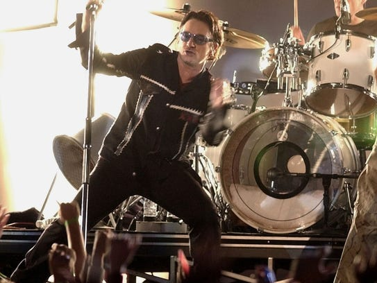 Bono, lead singer of the band U2, performs during halftime