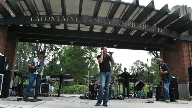 The 2XL Band rocks the LaFontaine Family Amphitheater stage as the headliner for the summer concert series Thursday, July 12, 2018.