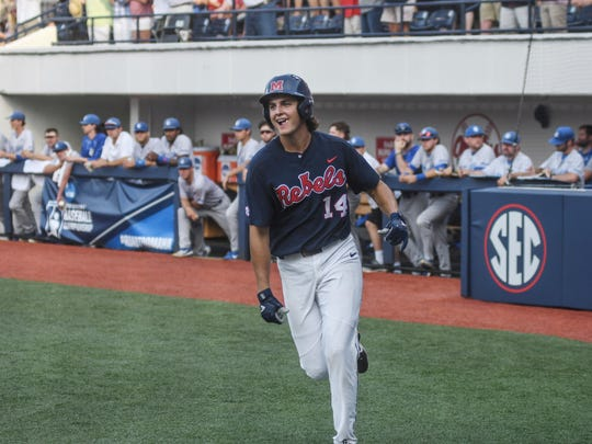 Mississippi's Cole Zabowski (14) smiles after scoring on his two-run home run against Saint Louis during an NCAA college baseball tournament regional game in Oxford, Miss., Saturday, June 2, 2018. (Bruce Newman/The Oxford Eagle via AP)