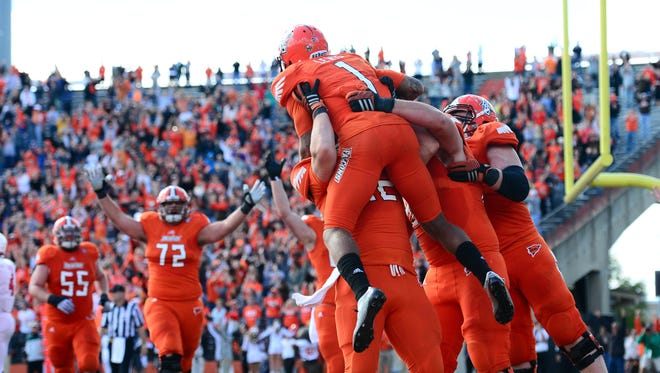 Bowling Green Falcons wide receiver Roger Lewis (1) celebrates with teammates after catching the game winning touchdown in the end zone during the fourth quarter against the Bowling Green Falcons at Doyt L. Perry Stadium. Bowling Green defeated Indiana 45-42.