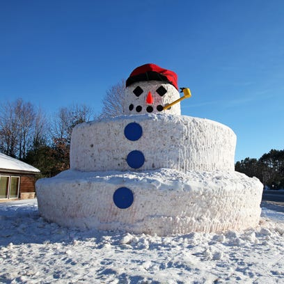 Minocqua's 30-foot-tall Snowmy Kromer snowman welcomes visitors to the Northwoods