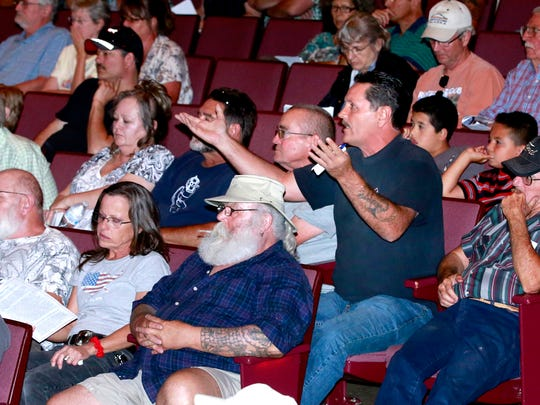 Crouch Mesa resident John Livingston asks a question during a meeting with officials of the New Mexico Public Regulation Commission, AV Water and New Mexico Environment Department on Thursday at the Farmington Civic Center.