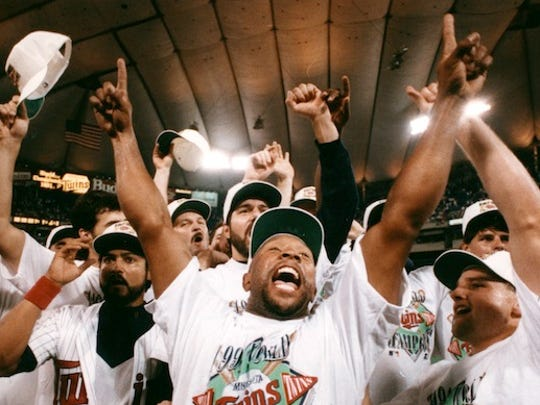 Kirby Puckett (center) led the Twins to the 1991 World Series title. No Minnesota team from the four major pro sports has won a title since.