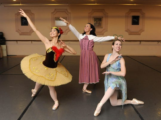 "Eri Nishihara, left, as The Robin, Maegen Price, center, as Mary Lennox, and Eve Allen as The Dragonfly in A.V.A. Ballet's 2011 ""Secret Garden."""