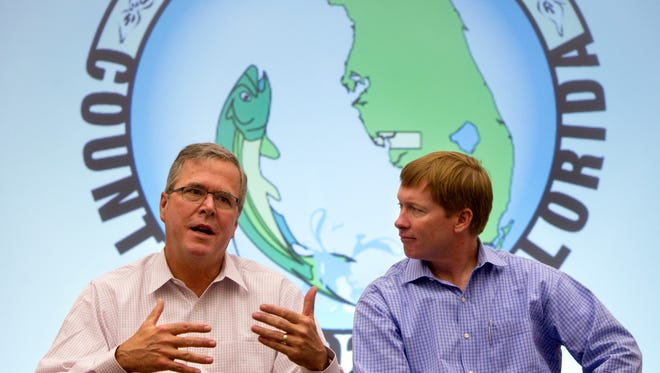 Former Florida Gov. Jeb Bush, left, and Florida Commissioner of Agriculture Adam Putnam, speak to Southwest Florida emergency response officials on the 10 year anniversary of Hurricane Charley on Wednesday in Punta Gorda.
