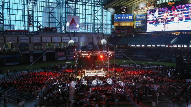 The scene at Minute Maid Park before Saturday night's bout between Canelo Alvarez and James Kirkland, the latest in a long line of big fights at baseball stadiums. (Troy Taormina-USA TODAY Sports)