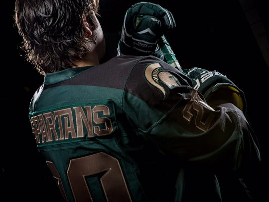 """MSU's alternate uniforms for the Hockey City Classic have black shoulders and bronze numbering and lettering. The word """"Spartans"""" replaces individual player names on the back of each jersey."""