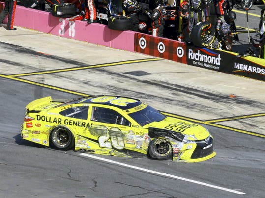 Matt Kenseth takes his damaged car to the garage area during the Sprint Cup race at Charlotte Motor Speedway in Concord, N.C., Sunday.