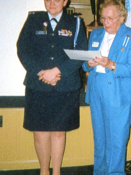Nancy Behney, regent of the Lebanon Chapter Daughters of the American Revolution, presents Emily McIntyre, a member of the Civil Air Patrol, with the National Society Daughters of the American Revolution Outstanding Cadet Award.
